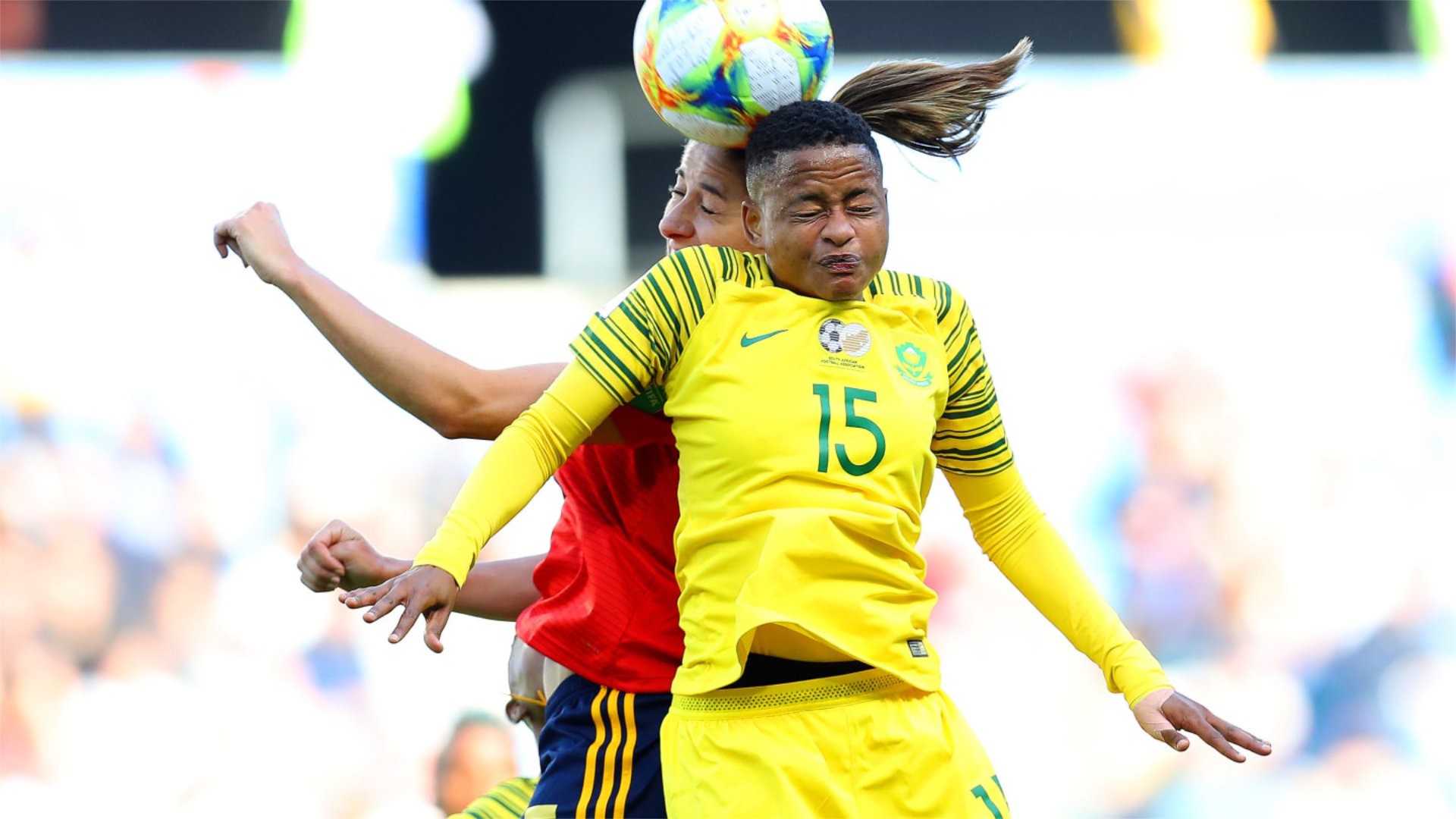 Refiloe Jane of South Africa jumps for the ball in the opening 2019 Soccer World Cup match against Spain.